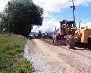 Contractors carry out scheduled maintenance on Ballantyne Rd in Wanaka on Thursday. Photo: Tim...