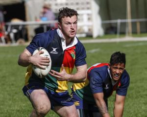 Otago Sassenachs Gold player Gavin Stark heads upfield during the North Otago Referees Sevens...