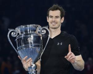 Andy Murray celebrates with the year-ending No 1 trophy. Photo: Reuters