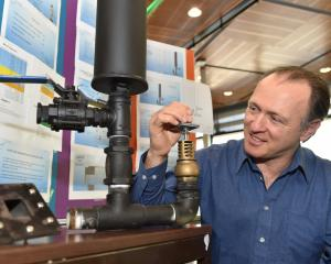 Otago Polytechnic bachelor of engineering technology student Pat Wall adjusts his hydraulic ram...