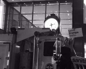 """Lady Gaga joined protests outside Trump Tower holding a sign saying """"Love trumps hate"""". Photo:..."""