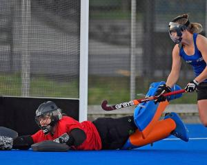New Black Sticks goalkeeper Ginny Wilson (also inset) stops the ball while fellow Southern player...