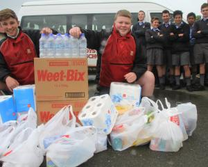 Armed with  supplies donated by the community, Waitaki Boys' High School years 9, 10 and 11...