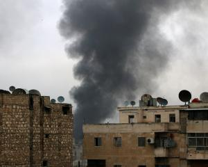 Smoke rises after strikes on the rebel-held besieged neighbourhoods of eastern Aleppo. Photo:...