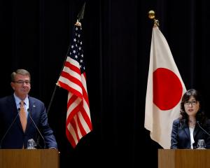 US Defence Secretary Ash Carter and Japan's Defence Minister Tomomi Inada attend a joint news...