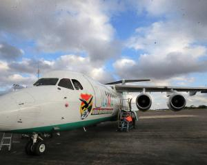 The Bolivian Lamia airlines plane which crashed this week is seen near Medellin, Colombia, in...