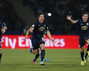 Auckland City players celebrate after their victory in a penalty shoot out against Cruz Azul in...