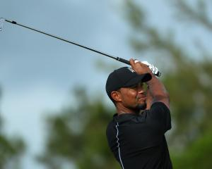 Tiger Woods hits his tee shot on the 12th hole during round one of the Hero World Challenge at...