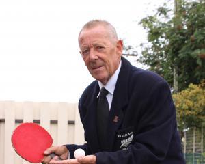 International table tennis umpire Bob (Ben) Hurr dons an official uniform at his Alexandra home....