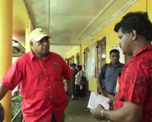 Fijian Prime Minister Voreqe Bainimarama visits a flooded area.