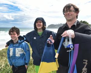 Marine reserve supporters Dannie Hawkins with his sons Dylan (12, left) and Chris (14) at St...