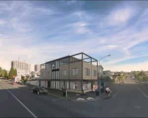 The proposed building for the site of the Campus Wonderful store on the corner of Union and Forth...