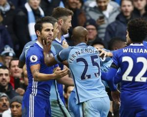 Manchester City's Fernandinho clashes with Chelsea's Cesc Fabregas before being sent off. Photo:...