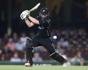 Colin Munro plays the ball through the offside for the Black Caps in the first Chappell-Hadlee...