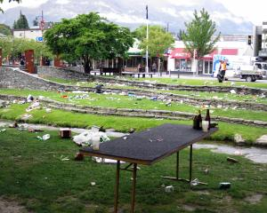 Rubbish is left scattered across the Village Green in Queenstown after the Crate Day on Saturday...