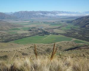 The effect of irrigation in the Omarama area is seen looking down on Twinburn, Dunstan Peaks,...