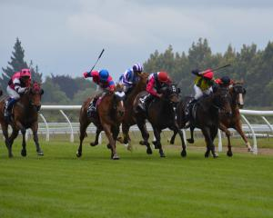Hot Date and Chris Johnson (third from right) find clear running to beat their rivals in race 3...