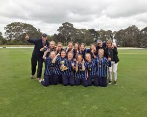Players and staff of the St Hilda's Collegiate First XI celebrate becoming national girls...