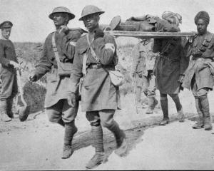 Four Indian soldiers carry one of their wounded officers in France. - Otago Witness, 6.12.1916.