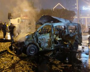 A damaged vehicle is seen after a blast in Istanbul. Photo: Reuters