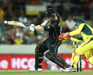 Jimmy Neesham bats for New Zealand against Australia in Canberra. Photo: Getty Images