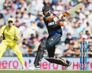 Grant Elliott averaged 61.33 batting second against Australia. Photo: Getty Images