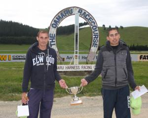Papakura's Sailesh (left) and Jay Abernethy  hold the spoils after winning the Brothers In Arms...