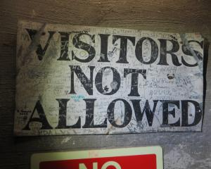 A no visitors sign inside the Waitaki Dam tagged by former staff members. Photos: Shannon Gillies.