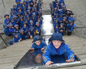 Papakaio School pupils Charlotte Elliot (8) and Eric Strachan (7) take a turn down the school's...