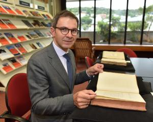 The Polish ambassador to New Zealand, Zbigniew Gniatkowski, reads 238-year-old book Observations...