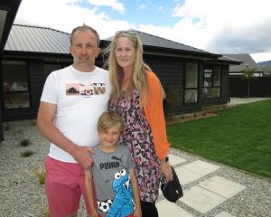 Peter Wilson with wife Lisa, son Calder (6) and their new Shotover Country home. Photo: Philip...