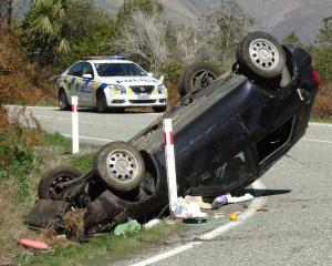 Police attend an accident between Glenorchy and Queenstown on Saturday.