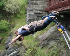 Wakatipu High School pupil Steph Arrowsmith (18) completes her first bungy jump with AJ Hackett...