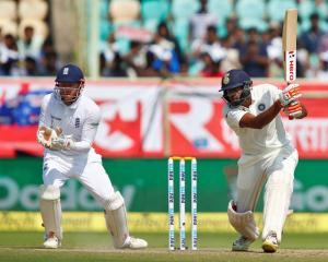 Ravi Ashwin plays a shot through the offside for India. Photo: Reuters