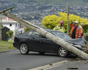 A power pole in Dunedin was felled by a Nissan car in Dunedin yesterday. Photo by Gerard O'Brien.