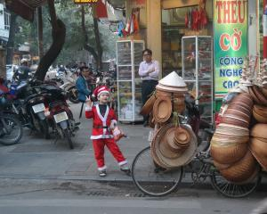 A young boy gets in the Christmas spirit on Christmas Eve in Hanoi.PHOTO: SUE MCALLISTER