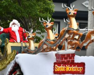 Saint Nick takes the 19th annual Santa Parade by storm as he arrives in the Octagon yesterday....