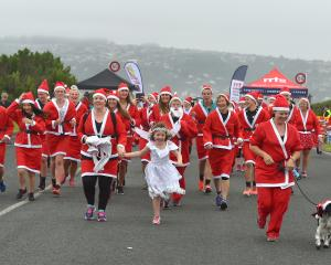 About 110 people dressed up as Santa for the Dunedin leg of the nationwide Great KidsCan Santa...