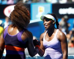 Sloane Stephens of the US (R) shakes hands with compatriot Serena Williams after defeating her in...