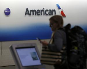A passenger arrives to check in for an American Airlines flight at O'Hare International Airport...