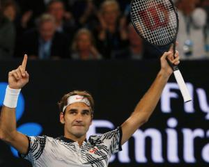 Roger Federer celebrates his win over Stan Wawrinka. Photo Reuters
