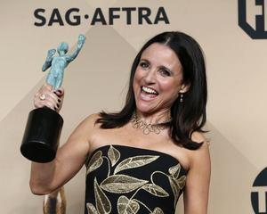 Julia Louis-Dreyfus poses with her award for the portrayal of a fictional US president. Photo:...