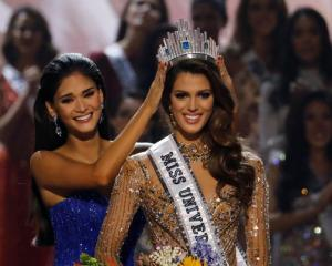 Pia Wurtzbach places the Miss Universe crown on Miss France Iris Mittenaere after the latter was...