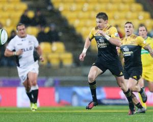 Beauden Barrett chases a loose ball during the Hurricanes win over the Sharks. Photo: Getty Images