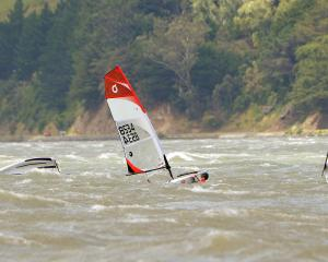 Young sailors battled winds gusting to 40 knots for the final race of the O'Pen Bic sailing...