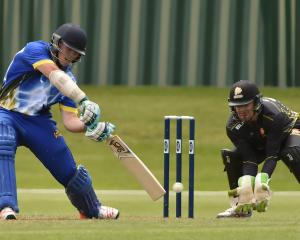 Otago batsman Michael Bracewell hits the ball through the offside to bring up his half-century...