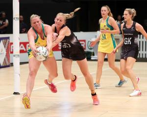 Australia's Caitlin Thwaites and New Zealand's Katrina Grant compete for the ball. Photo: Getty...
