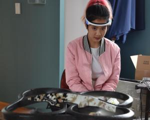 Secondary school pupil Gabby Wu (15), of Wellington, controls a drone using mind power during a '...