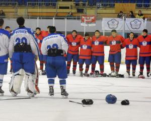 The Israel (left) and Chinese Taipei teams line up for the post-match ceremony after their game...