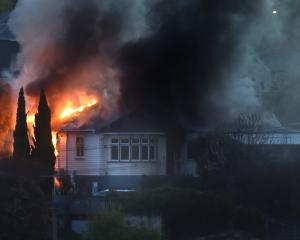 The fire quickly engulfed the house in Concord. Photo: ODT